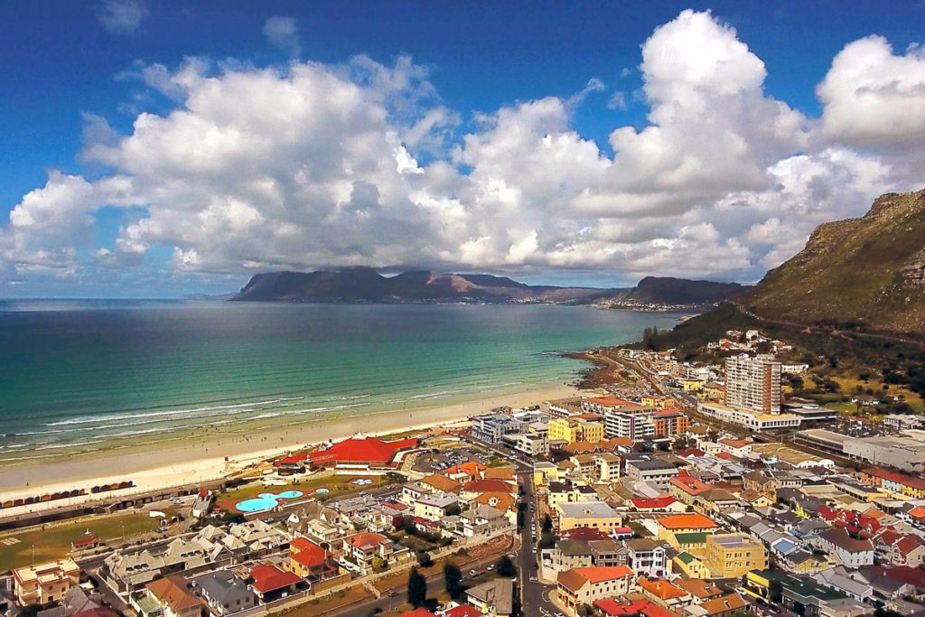 An aerial view of Muizenberg town and beach